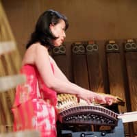 Highly strung: Michiyo Yagi uses traditional acoustic koto alongside a specially made electric koto.   KATHERINE WHATLEY