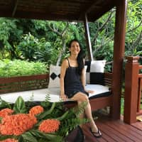 Wanderlust: Tomoko Houtzager, here on a trip to Thailand, has always loved to travel. She now lives on a farm in New South Wales, Australia.