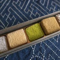 New lexicons of taste: A box of Jahana Kippan Ten's kippan (sweets made with kunenbo citrus fruit) topped with coconut and powdered green tea. | STEPHEN MANSFIELD