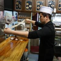 Handmade with flair: The chef at Urumqi makes laghman noodles by spinning the dough through the air, which gives the noodles their unique, springy texture. | CARLA RODRIGUEZ