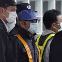 Maintaining his innocence: Former Nissan Chairman Carlos Ghosn leaves the Tokyo Detention House on Tuesday following his release on bail. | BLOOMBERG