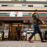In the line of fire: Seven-Eleven Japan Co. franchises are required to keep their stores open 24/7. | BLOOMBERG