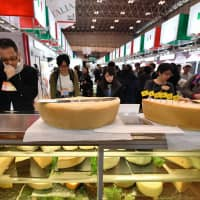 Booths at the Italian pavilion serve fine cheeses, coffee and other gourmet items at Foodex Japan 2019 at Makuhari Messe, Chiba | YOSHIAKI MIURA