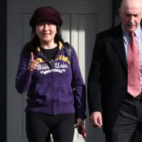 Huawei CFO Meng Wanzhou, under house arrest, is shown leaving her home in Vancouver, Canada, on March 6.   REUTERS