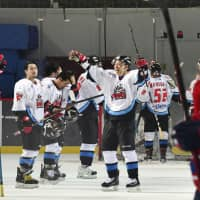 The Nippon Paper Cranes celebrate their victory over the Daemyung Killer Whales on Thursday in the Asia League Ice Hockey semifinals in Incheon, South Korea. | KYODO