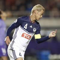 Victory captain Keisuke Honda celebrates after scoring the game-tying equalizer against Sanfrecce on Tuesday in Hiroshima. | KYODO