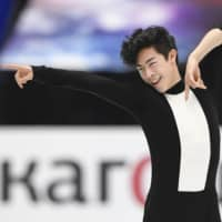 Nathan Chen rises to occasion in short program, builds commanding lead at world championships