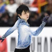Two-time Olympic champion Yuzuru Hanyu performs his short program at the world championships on Thursday. Hanyu is in third place with 94.87 points. | KYODO