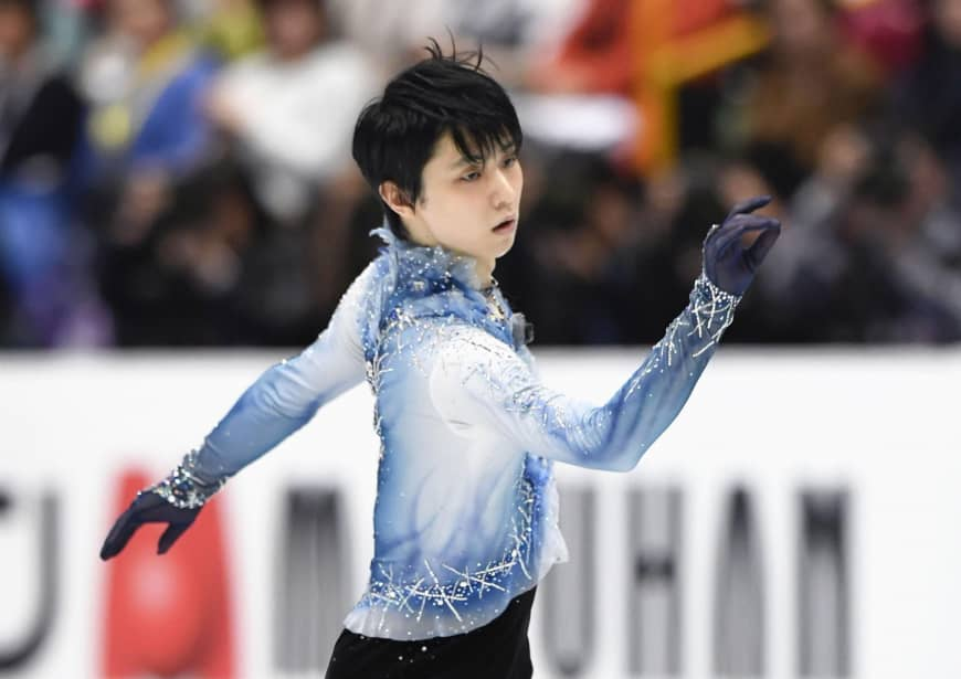 Two-time Olympic champion Yuzuru Hanyu performs his short program at the world championships on Thursday. Hanyu is in third place with 94.87 points.
