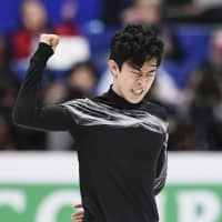 Nathan Chen reacts after his free skate. | KYODO
