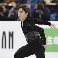 Keiji Tanaka competes in the men's short program on Thursday. Tanaka is in 19th place with 78.76 points. | KYODO