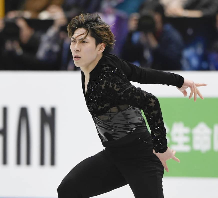 Keiji Tanaka competes in the men