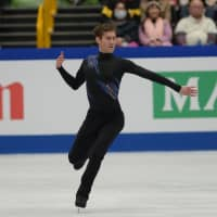Jason Brown performs his short program at Saitama Super Arena on Thursday. The American skater is in second place after scoring 86.81 points. | DAN ORLOWITZ