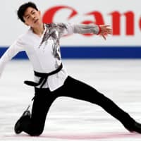 Vincent Zhou competes to 'Crouching Tiger, Hidden Dragon' in the men's free skate. The American claimed the bronze with 281.16 points. | REUTERS