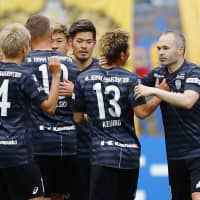 Andres Iniesta (right) and his Vissel teammates celebrate their win over Vegalta on Sunday at Yurtec Stadium. | KYODO