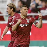 Vissel captain Lukas Podolski celebrates after scoring the team's opening goal against S-Pulse on Sunday at Noevir Stadium. | KYODO