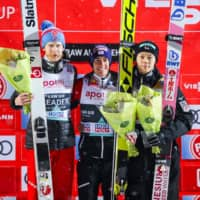 Third-place finisher Ryoyu Kobayashi (right) poses with second-place Robert Johansson (left) and winner Stefan Kraft after the FIS Men's Ski Jumping World Cup event in Lillehammer, Norway, on Tuesday. | AFP-JIJI