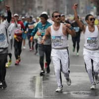 Runners dressed as Freddie Mercury, the main character in the popular Oscar-winning film 'Bohemian Rhapsody,' participate in Sunday's Tokyo Marathon along with other entrants wearing a variety of costumes. | RYUSEI TAKAHASHI