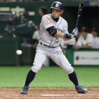 Mariners right fielder Ichiro Suzuki is called out on strikes against the Giants in the fourth inning of their preseason exhibition game at Tokyo Dome on Monday. | AP