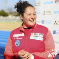 Suzuka Unlimited manager Milagros Martinez Dominguez speaks to reporters following her team's win over Tegevajaro Miyazaki on Sunday in Suzuka, Mie Prefecture. The 33-year-old became the first woman to manage a team to victory in one of Japan's national men's soccer leagues.