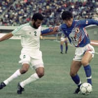 Kazuyoshi Miura dribbles the ball past Saudi Arabia's Abdullah Al-Dosari during the the 1992 Asian Cup Final in Hiroshima. Japan won 1-0 for its first continental title. | KYODO