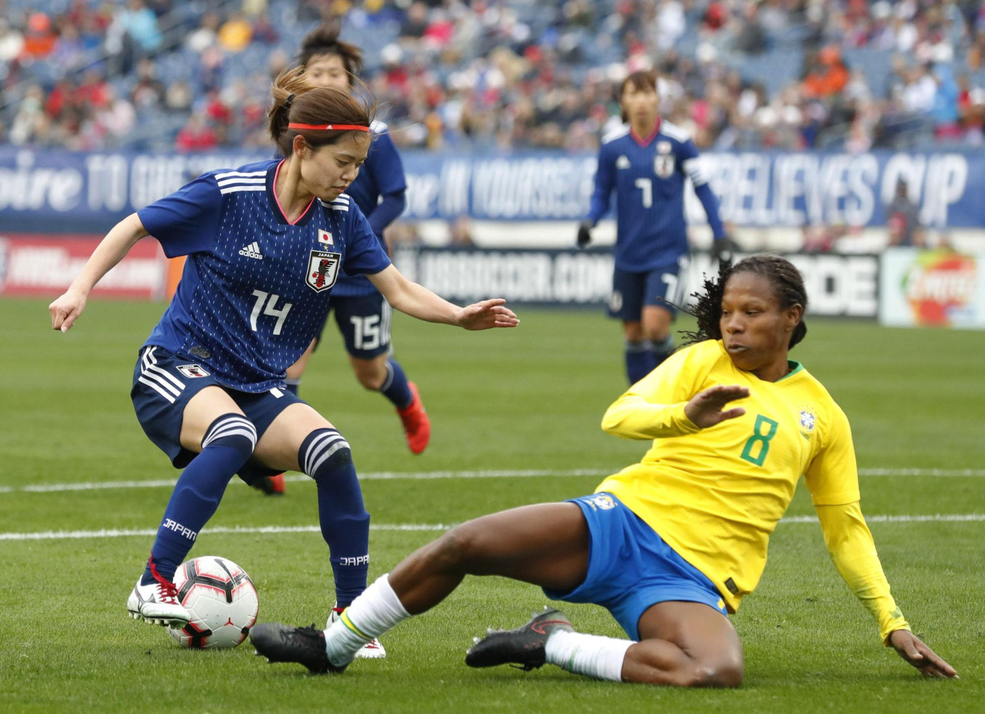 Nadeshiko Japan's Yui Hasegawa controls the ball as Brazil's Miraildes defends during their match at the SheBelieves Cup on Saturday in Nashville, Tennessee. Japan won 3-1.   KYODO