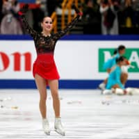 Alina Zagitova reacts after her performance in the women's free skate. | REUTERS