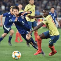 Colombia's Deiver Machado (right) and Japan's Sei Muroya vie for the ball during Friday's friendly. | AFP-JIJI