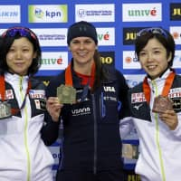 Women's 1,000-meter winner Brittany Bowe (center) poses with second-place finisher Miho Takagi (left) and Nao Kodaira, who earned bronze, at a World Cup speedskating event on Saturday in Salt Lake City. | AP