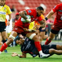 Rahboni Warren Vosayaco of the Sunwolves carries the ball against the Lions in Singapore on Saturday. | REUTERS