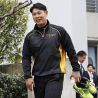 Tigers backup catcher Fumihito Haraguchi returns to practice on Thursday in Nishinomiya, Hyogo Prefecture. | KYODO