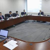A panel working for the Ministry of Internal Affairs and Communications holds a meeting Wednesday to allocate mobile phone frequency bands for superfast 5G services. | KYODO