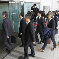 Transport ministry officials enter a Japan Airlines Co. office at Haneda airport in Tokyo in November. | KYODO