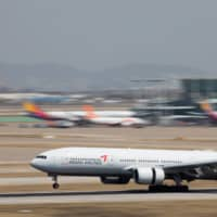 A Boeing Co. 777-200 aircraft operated by Asiana Airlines Inc. lands at Incheon International Airport in South Korea on Monday. | BLOOMBERG