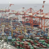 Japan logged a goods trade deficit of ¥1.59 trillion in the year through March, according to the Finance Ministry. | KYODO