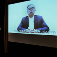 A video of Carlos Ghosn, filmed on April 3, is seen on April 9 at the Foreign Correspondents' Club of Japan in Tokyo.