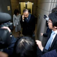 Former Nissan Chairman Carlos Ghosn leaves his lawyer's office in Tokyo on March 12. | REUTERS