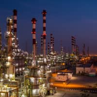 Lights illuminate cracking towers at the Persian Gulf Star Co. (PGSPC) refinery in Bandar Abbas, Iran, in January this year. | BLOOMBERG