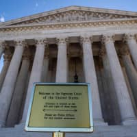 The United States Supreme Court is seen in Washington April 15. The Supreme Court said Monday it will take up the question of whether gay and transgender workers are protected by federal law that bars discrimination in the workplace. | AFP-JIJI