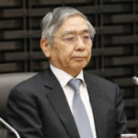 Bank of Japan Gov. Haruhiko Kuroda attends a meeting Monday in Tokyo of the BOJ's regional branch managers. | KYODO