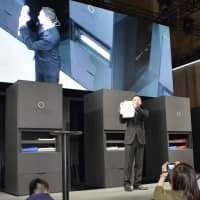 Shinichi Sakane, president of Seven Dreamers Laboratories Inc., introduces its Laundroid machine at the annual Combined Exhibition of Advanced Technologies, or CEATEC, at Makuhari Messe convention center in Chiba in October 2016. | KYODO