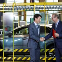 Fred Volf (right), president of Toyota Motor Manufacturing Canada Inc., meets with Justin Trudeau, Canada's prime minister, in front of a Lexus NX300 vehicle at the company's manufacturing facility in Cambridge, Ontario, on Monday. Volf said that the automaker will produce the Lexus NX crossover, in gasoline and hybrid versions, beginning in 2022 at the plant. | BLOOMBERG