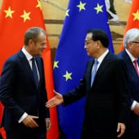 China wants to work with EU on trade and is not trying to split east from west, premier writes