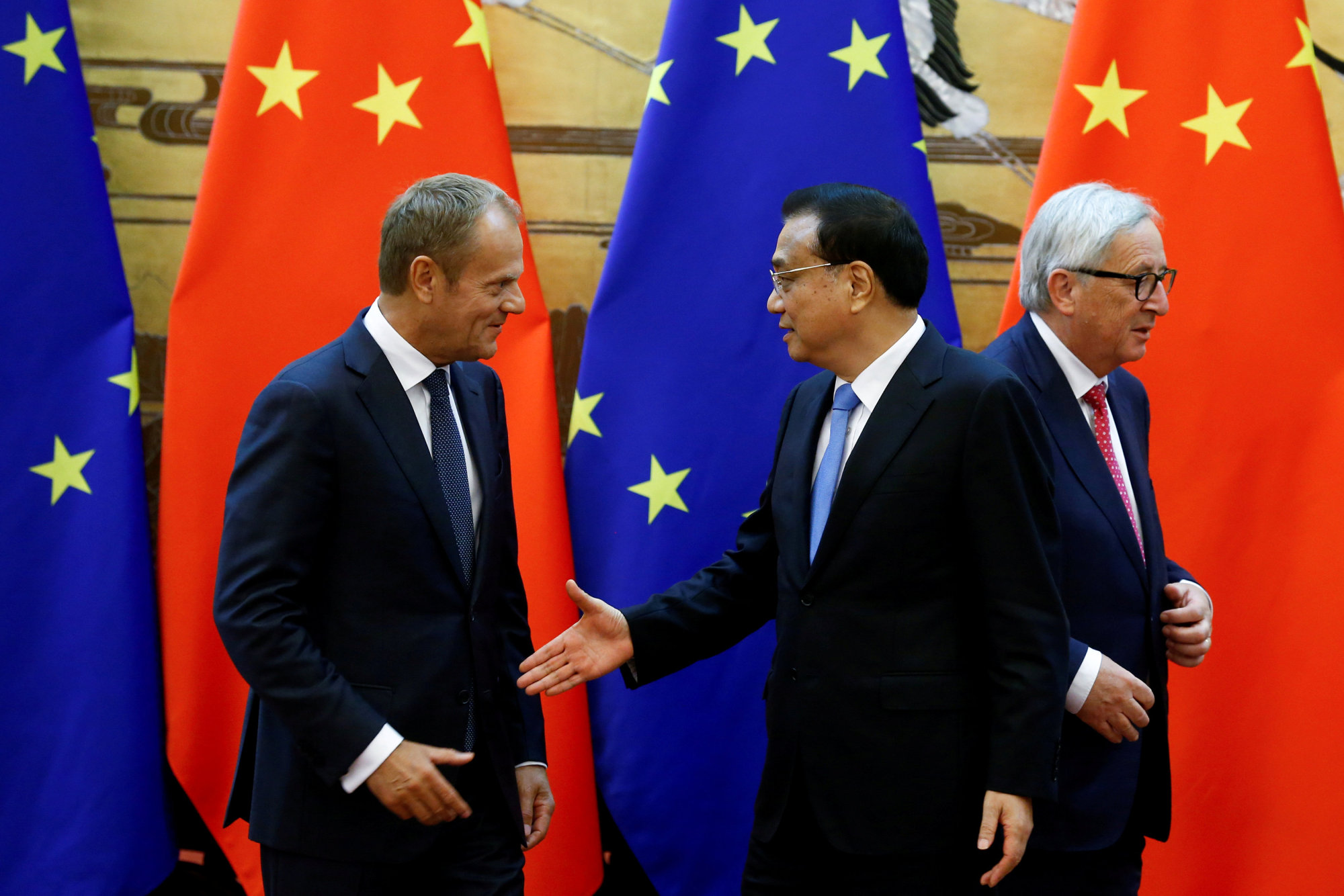 European Council President Donald Tusk, Chinese Premier Li Keqiang (center) and European Commission President Jean-Claude Juncker attend a signing ceremony at the Great Hall of the People in Beijing last July. | REUTERS