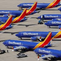 Grounded Southwest Airlines Boeing 737 Max 8 aircraft are parked at Victorville Airport in Victorville, California, March 26. | REUTERS