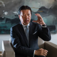 Yoshihisa Kainuma, chairman and chief executive officer of Minebea Mitsumi Inc., speaks during an interview in Tokyo on April 1. Minebea, dubbed the 'King of Deals' in local media, has grown the firm from a small ball bearing manufacturer on the outskirts of Tokyo to a key player in the tech industry's global supply chain. | BLOOMBERG