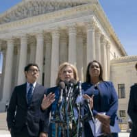 Rep. Carolyn Maloney, D-N.Y. (center), joined from left by Dale Ho, attorney for the American Civil Liberties Union, New York State Attorney General Letitia James, and New York City Census Director Julie Menin, speaks to reporters after the Supreme Court heard arguments over the Trump administration's plan to ask about citizenship on the 2020 census, in Washington Tuesday. | AP