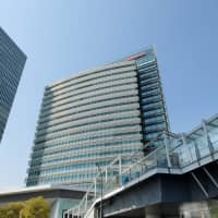 Tthe Nissan Motor headquarters in Yokohama is seen Saturday. Nissan shareholders are expected to eject Carlos Ghosn from its board on Monday as the detained former chairman fights multiple charges of financial misconduct that have landed him in custody. | AFP-JIJI