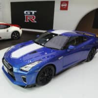 New models of Nissan Motor Co.'s GT-R (front) and Fairlady Z, both marking the 50th anniversary of their release, are displayed at a showroom in Tokyo on Wednesday. | KYODO