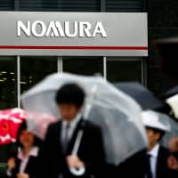 Nomura to reduce outlets in Japan by 20%
